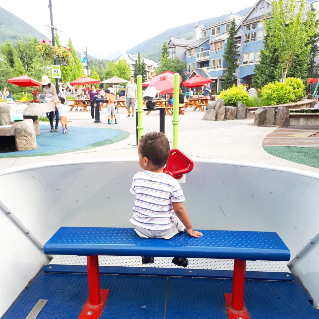 Child on family vacation in the park at Olympic Village Park